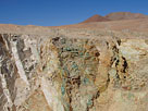 Copper mineralization in wall of hand dug open pit in the Atacama Region, Chile